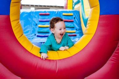 Happy toddler peeking on trampoline