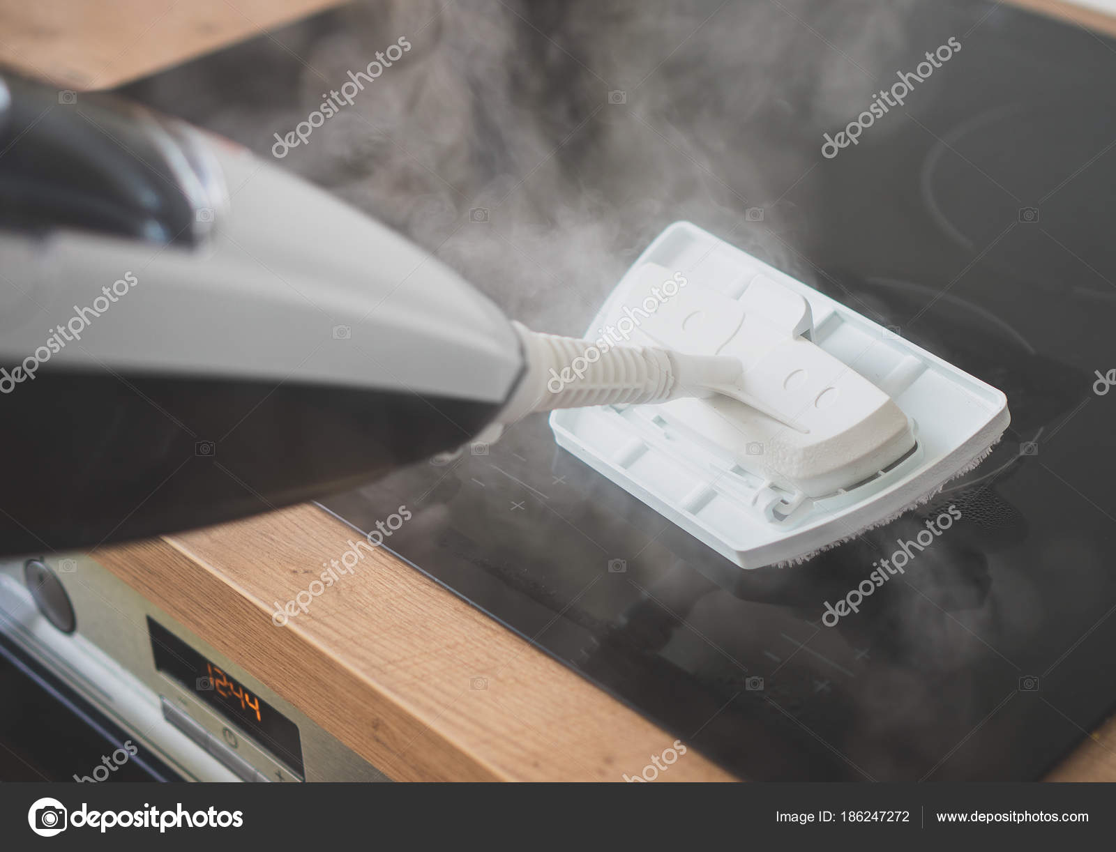 Cleaning kitchen hob with a steam cleaner. — Stock Photo ...