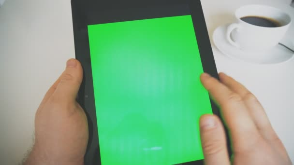 Hand holding tablet pc with green screen. Chroma key.
