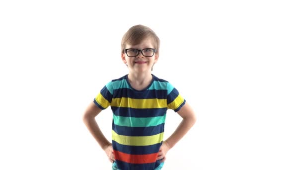 studio portrait of a smiling boy on a white background. first grader with glasses