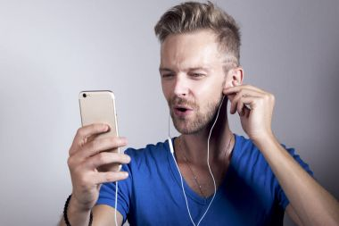 Young hipster listening to music