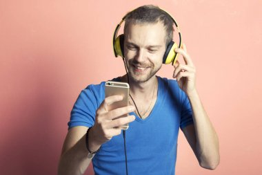 Happy man listening to music on his phone