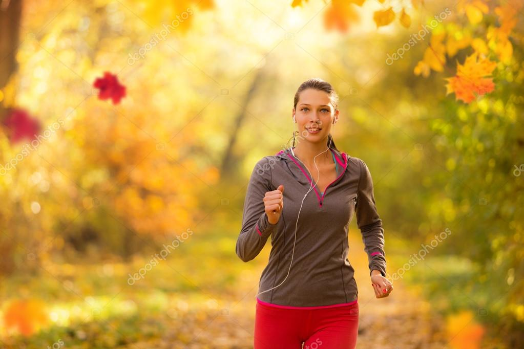 Athlete young woman running in morning