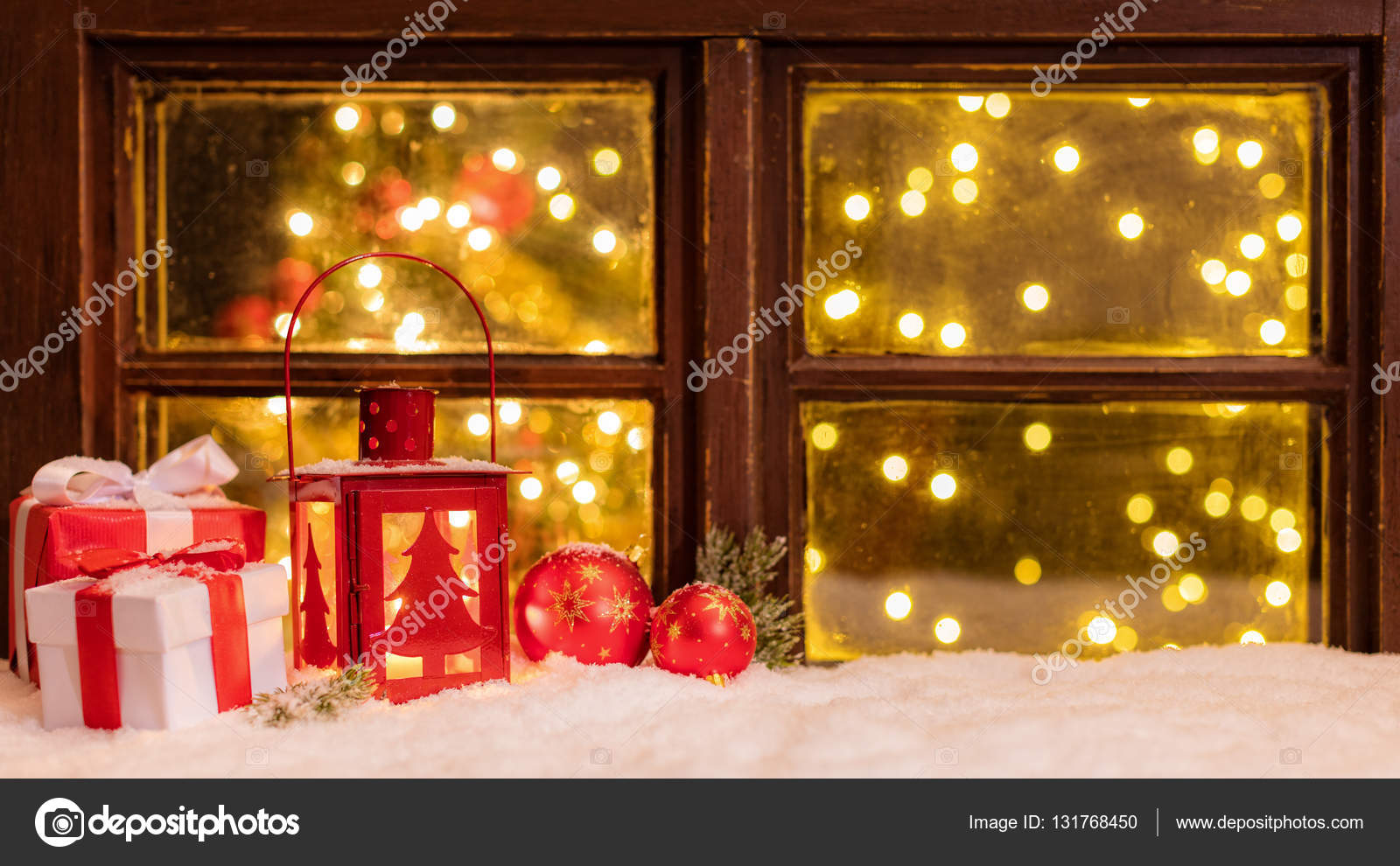 atmospheric christmas window sill with decoration and blur tree wth lights inside photo by jag_cz