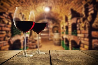 Small wine cellar with two glasses of wine
