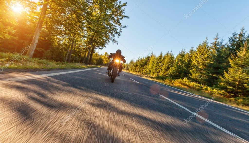 Motorcycle driver on road