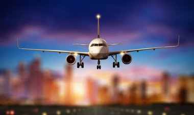 Front view of commercial airplane, blur modern city on background