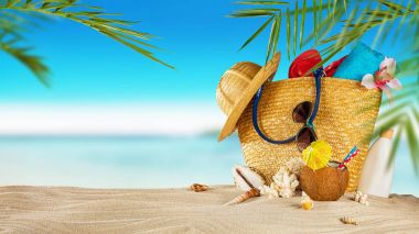 Tropical beach with accessories on sand, summer holiday backgrou