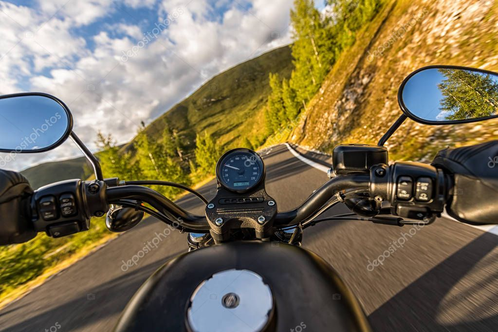 Detail of motorcycle handlebars. Outdoor photography, Alpine lan