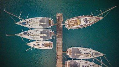 Group of sailing boats anchoring in marina