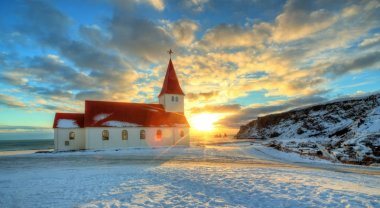 Typical red colored wooden church in Vik town, Iceland
