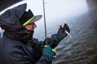 Sport fisherman showing plastic bait fish.