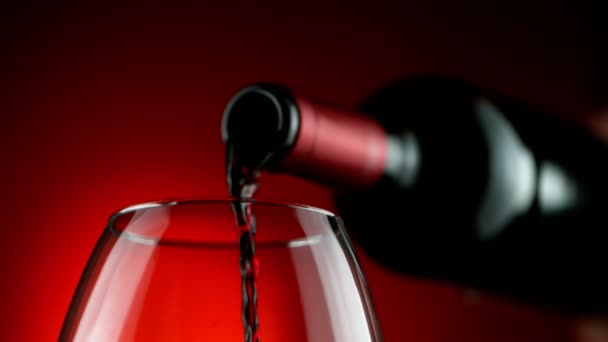 Super slow motion of pouring red wine, macro detailed shot. Filmed on high speed cinema camera, 1000fps.