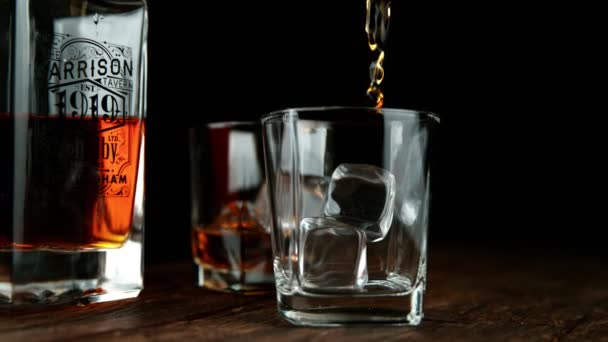Super slow motion of pouring whiskey or rum with slide motion. Filmed on high speed cinema camera, 1000 fps