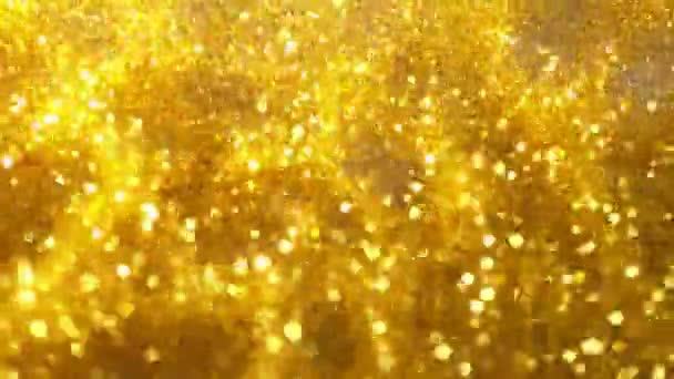 Szuper lassított felvétel csillogó arany részecskék fekete háttér. Sekély fókusz. Nagysebességű mozi kamera, 1000 fps.