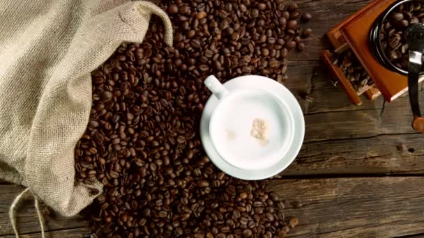 Super slow motion of falling sugar canes into coffee cup. Filmed on high speed cinema camera, 1000 fps.