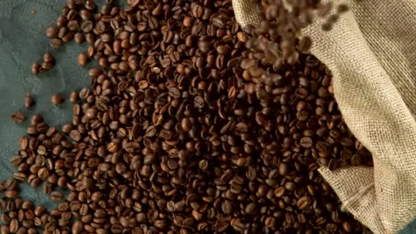 Super slow motion of falling coffee beans. Filmed on high speed cinema camera, 1000 fps.