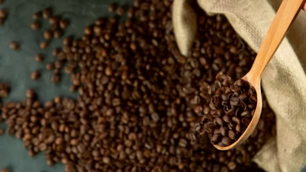 Super slow motion of falling coffee beans from spoon. Filmed on high speed cinema camera, 1000 fps.