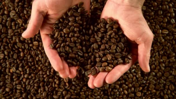 Super slow motion of male hands pouring coffee beans. Filmed on high speed cinema camera, 1000 fps.