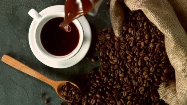 Super slow motion of pouring coffee into cup, high angle view. Filmed on high speed cinema camera, 1000fps.