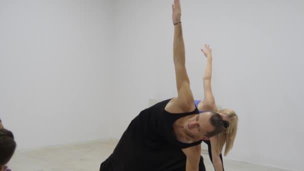 Yoga class multi racial group exercising healthy lifestyle in fitness studio yoga asanas