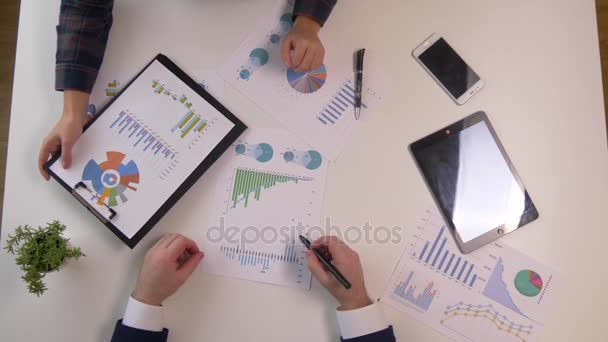 Business team meeting discussion. Professional investor working with new startup project. Finance managers task.Digital tablet laptop computer smarphone and finance charts
