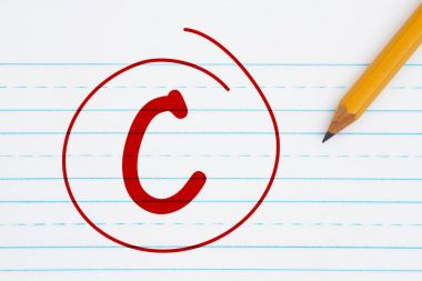 Getting a C grade, Retro lined paper with a pencil with text C and a circle in red stock vector