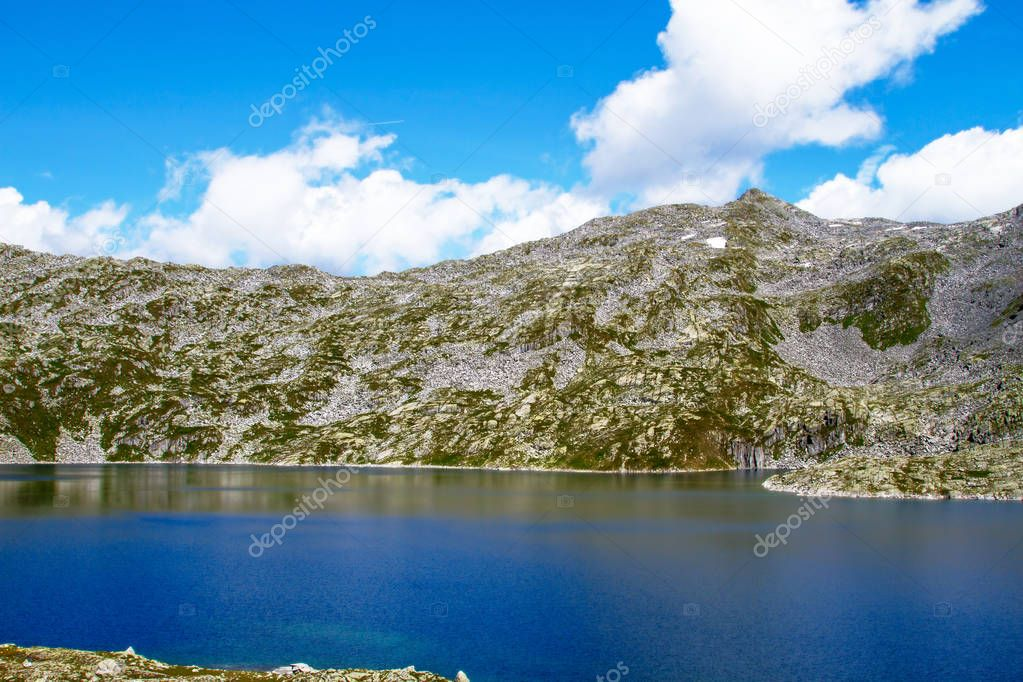 Scenery of high mountain with lake and rocky mountain Brescia, I