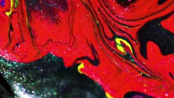Abstraktní pozadí z pestrobarevných pohyblivých tekutých barev. Natáčení maker