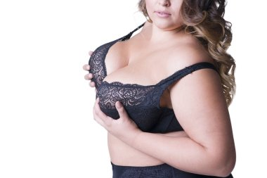 Plus size model in black lingerie, overweight female body, fat woman with big natural breasts posing isolated on white background stock vector