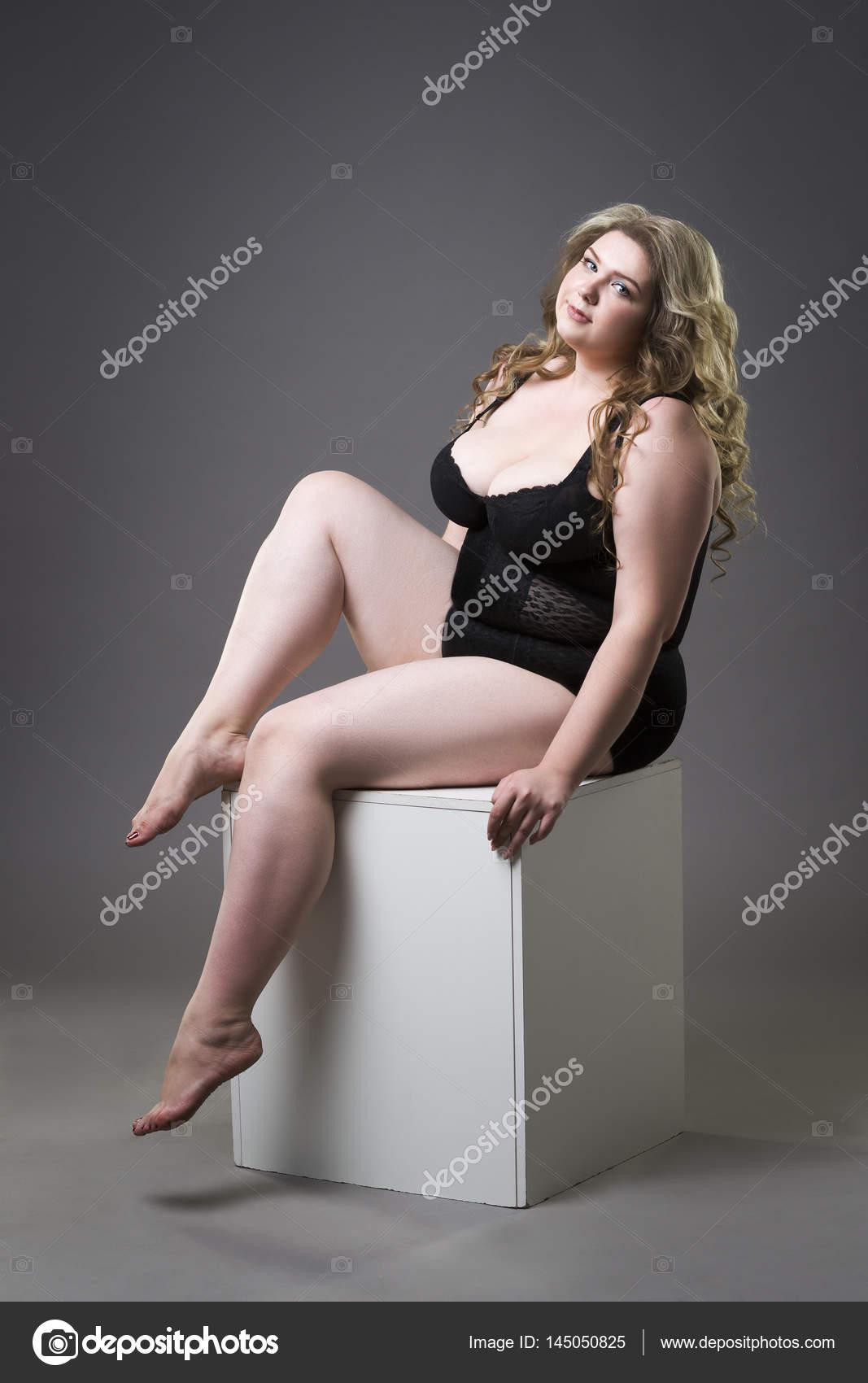 Young beautiful blonde plus size model in shapewear, xxl ...