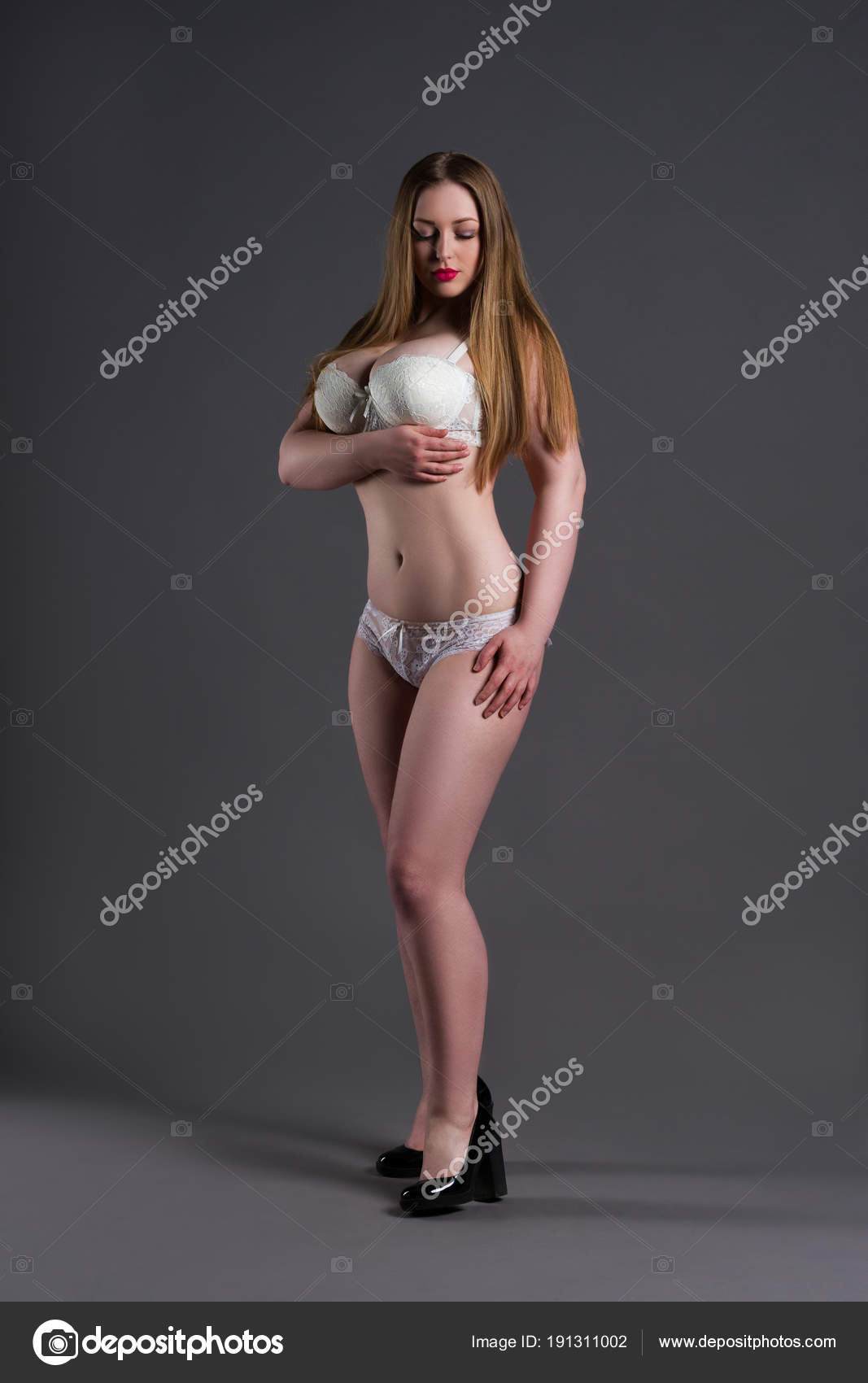 Plus size sexy model in white underwear fat woman on gray studio background overweight female body full length portrait photo by starast
