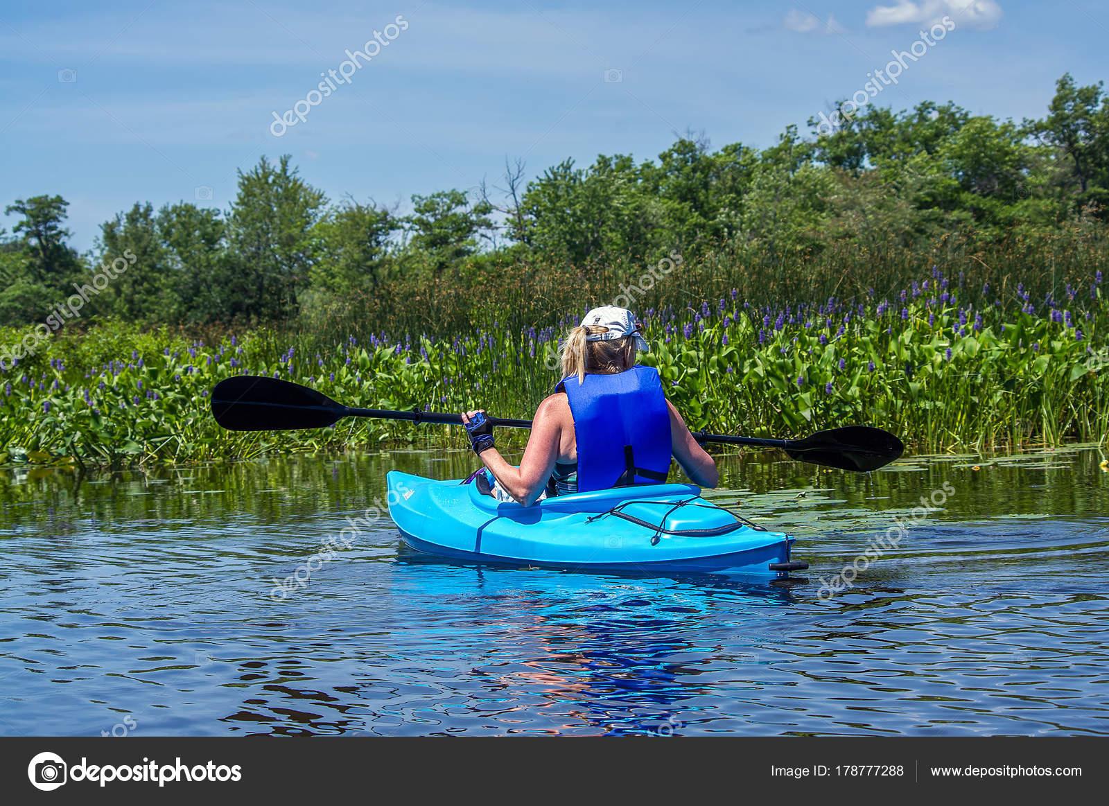 lone female kayak river wilderness stock photo brhamms 178777288