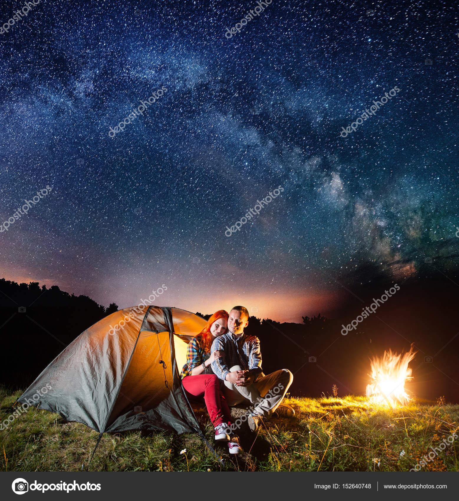 Night camping. Romantic couple — Stock Photo © anatoliy ...
