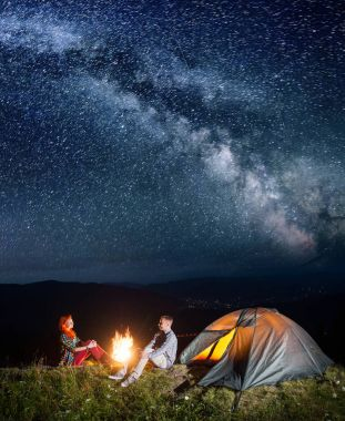 Night camping. Happy couple backpackers