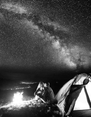 Night camping. Tourist family