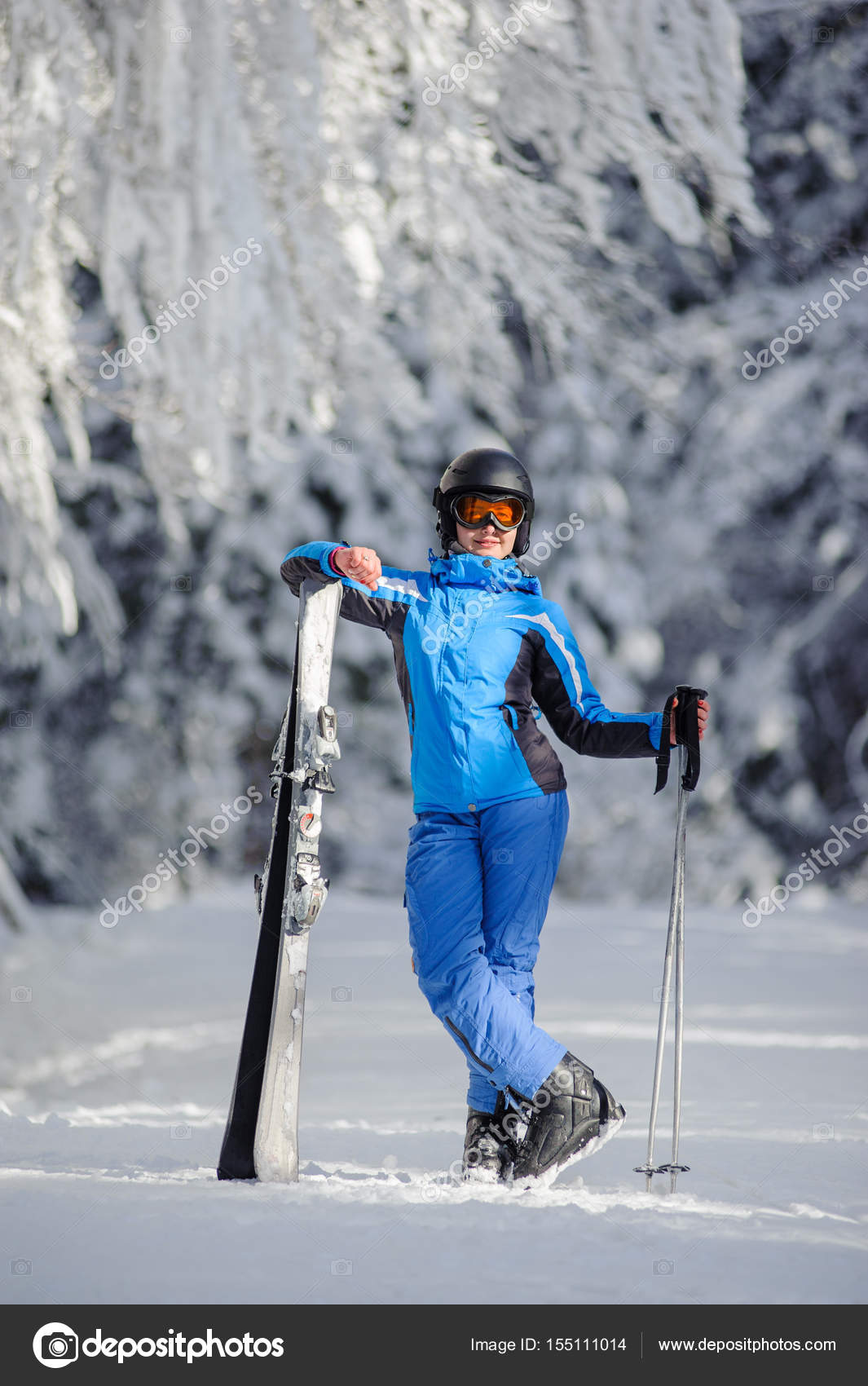 b7268ba119db Happy woman skier on a ski slope in the forest — Stock Photo ...