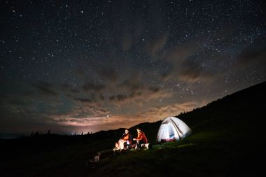 Couple of tourists at night camping