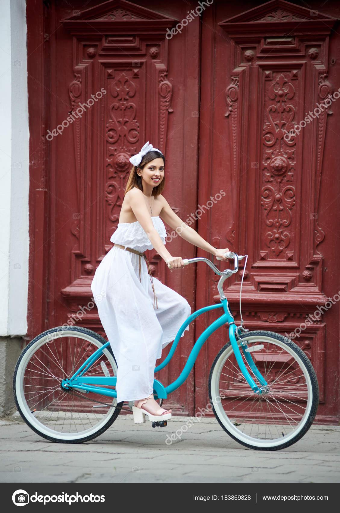 a3efda07d8e depositphotos 183869828-stock-photo-woman-long-light-dress-sitting.jpg