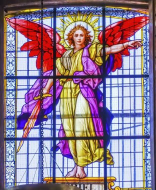 Puebla, Mexico - January 5, 2019 Colorful Archangel Uriel Stained Glass Basilica Cathedral Puebla Mexico. Built in 15 to 1600s.