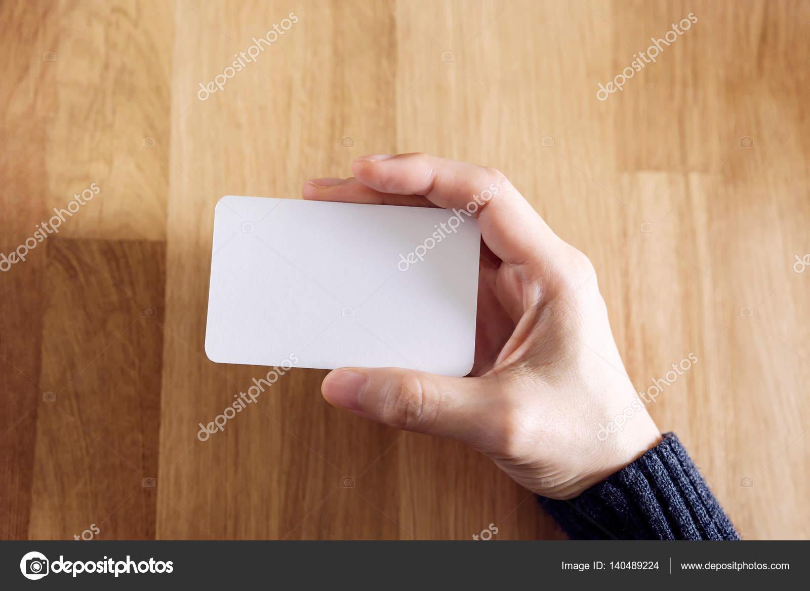 Woman holding blank business card — Stock Photo © sirinapawannapat ...
