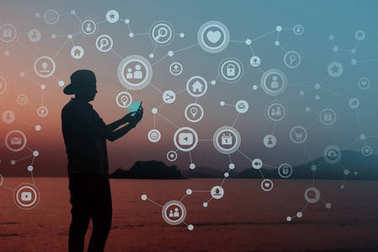 Always Connected concept, Silhouette of Young human using smart phone to Communicate in Network, Beach or Countryside as background
