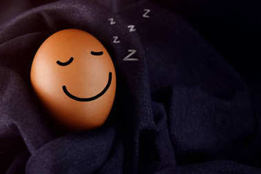 Comfort and Relaxation Concept, Happy Egg Sleeping with Smiley Face in Warm fabric place at Night