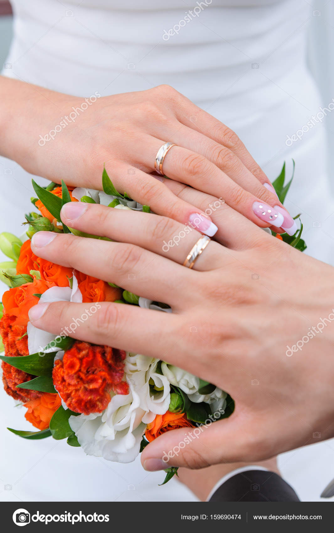 Couples hand with wedding rings — Stock Photo © kaznadey #159690474
