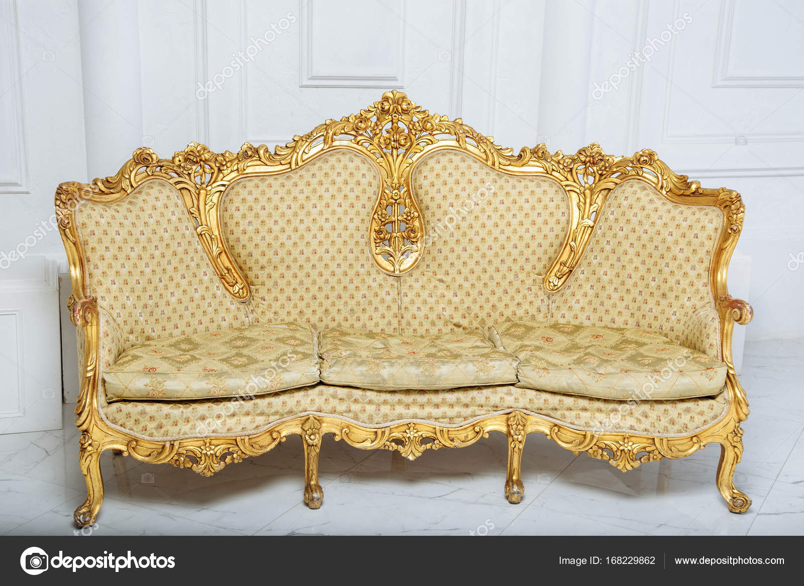Luxurious Golden Sofa On A Background Of Old White Wall U2014 Stock Photo