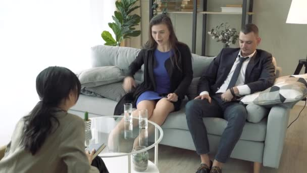Young couple visiting professional marital therapist. Reconciliation.