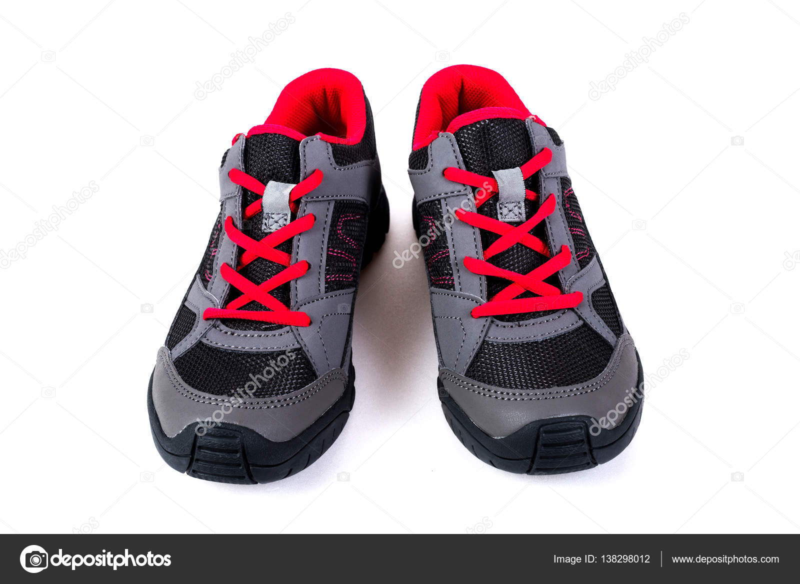 a472ff7b Zapatillas infantil rosa y gris sobre un fondo blanco — Foto de Stock