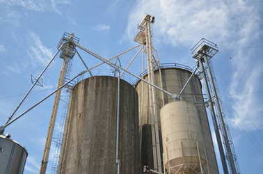 Industrial grain silos against blue sky