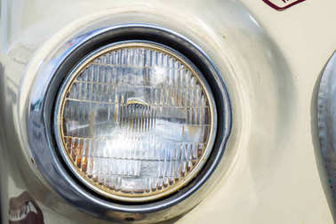 Classic car with close-up on headlights or Headlight lamp of retro car vintage style.
