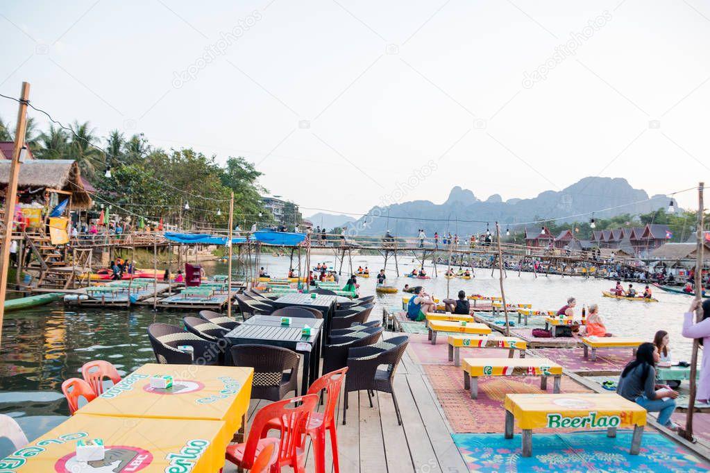 Vangviang, Laos - Feb 18 :Unidentified tourists rest in riverfront restaurant on Feb 18, 2017 in Vangviang, Laos